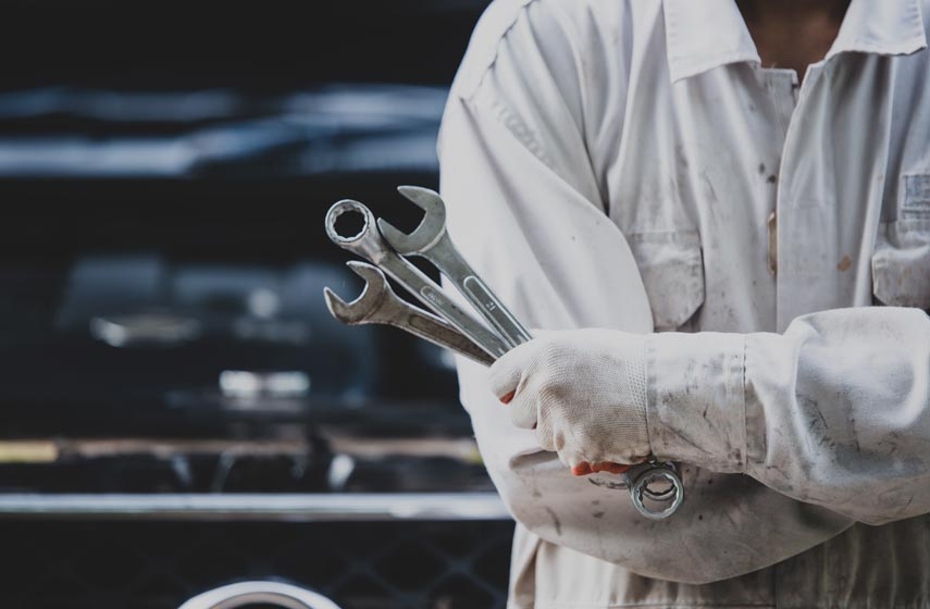 car-repairman-wearing-a-white-uniform-standing-and-holding-a-wrench-that-is-an-essential-tool-for-a-mechanic.jpg