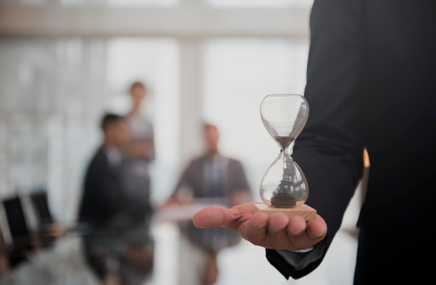 businessman-holding-hour-glass-signifies-importance-being-time.jpg