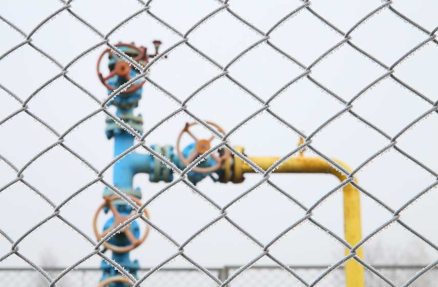gas-valve-with-fence-in-the-foreground.jpg